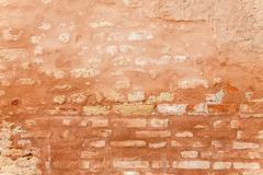 Porous Texture Of A Medieval Brick Wall - stock photo
