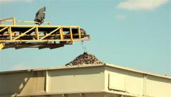 Stones falls from conveyor belt on pile.Sand separation in construction industry Stock Footage