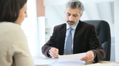 Attorney and client meeting in office for signature - stock footage