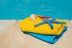 Towels at the swimming pool Stock Photos