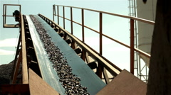 Wet sand going up on conveyor belt and falling down on pile. Separation of sand. Stock Footage