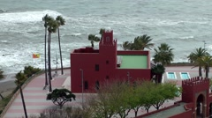 Bil Bil castle stormy weather waves blowing palm trees red walls Stock Footage
