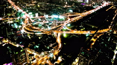 Highway interchange time-lapse night with flowing light energy Stock Footage