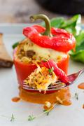 Baked stuffed peppers with meat sauce and cheese - stock photo