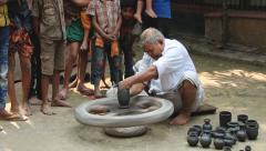 Man demonstrates traditional pottery production process in Tangail, Bangladesh. Stock Footage
