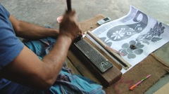 Man produces memory card for a jacquard loom in Tangail, Bangladesh. Stock Footage
