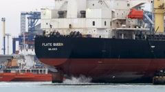 Back view of the bulker ship with rotating propeller on stern Stock Footage