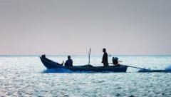 KAMALA, PHUKET, THAILAND - Silhouette of local fishermen cruise - stock footage