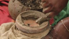 Woman seals with clay pot with rice seeds in Tangail, Bangladesh. Stock Footage