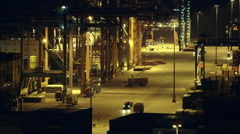 Real time ,night ,trading port activity trucks vehicles machinery - stock footage