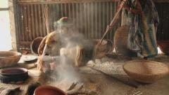 Women produce traditional dry fried rice in Tangail, Bangladesh. - stock footage