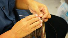 BANG PA-IN, THAILAND - Local artist weaving a traditional-sty Stock Footage