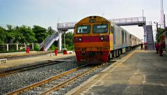 BANG PA-IN, THAILAND - Diesel-powered passenger train slows Stock Footage