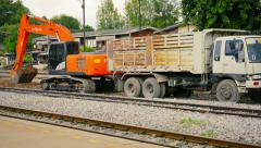 LOPBURI, THAILAND - Heavy equipment digging into rail bed  Stock Footage