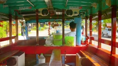 SUKHOTHAI, THAILAND - Riding in an old, empty bus Stock Footage