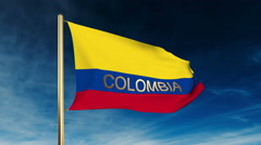 Colombia flag slider style with title. Waving in the wind with cloud background Stock Footage