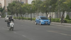 Traffic in front of MCOT Office Stock Footage