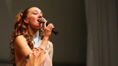Girl singing on the stage. Stock Footage