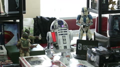 Toys and symbolism of the film Star Wars on store shelves. Stock Footage