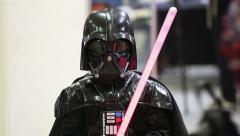 Star Wars Cosplay show. Little boy dressed as Darth Vader. Stock Footage