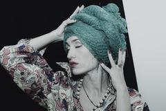 Portrait of woman wearing a woman's headdress Stock Photos