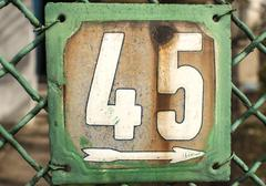 Weathered enameled plate number 45 Stock Photos