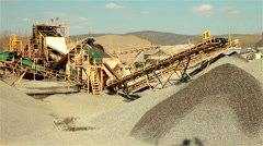 Big conveyor for separation of sand in construction industry. Large pile of sand Stock Footage