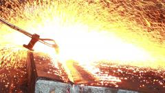 Stock Video Footage of Industry steel, Background peeling of slab, Flakes flame by blowing gas.