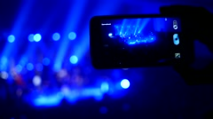 Filming video via smart phone on a music concert Stock Footage