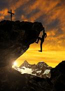 Stock Photo of Silhoutte of girl climbing on rock