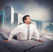 Businessman sinks into despair - stock illustration
