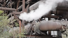 Smoke / steam from a rusty pipe Stock Footage