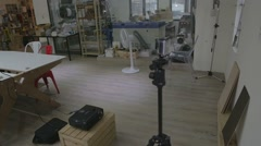 Gopro taking a timelapse of a co-working space Stock Footage