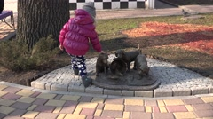 Adorable Cute Young Girl with Decorative Puppies in Park. 4K UltraHD, UHD Stock Footage