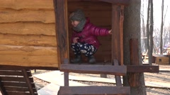 Little Girl in Wooden Playhouse. 4K UltraHD, UHD Stock Footage