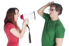 Woman Shouting to her Man with Megaphone Stock Photos