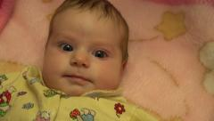 Portrait of a Surprised  Baby Girl. 4K UltraHD, UHD Stock Footage