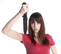 Close up Scary Woman Holding a Sharp Knife Up - stock photo