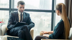 Business with colleagues in meeting room - stock footage
