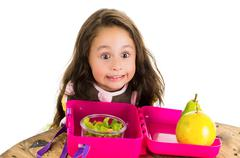 Cute little brunette girl with her healthy lunchbox - stock photo