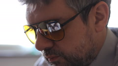 Sexy body Reflection on sunglasses watching   nudity on computer  - stock footage