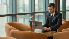 Business man at work time with laptop - stock footage