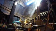 Sun rays streaming through a dusty Tibetan Kitchen No.1 Stock Footage