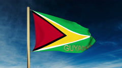 Guyana flag slider style with title. Waving in the wind with cloud background Stock Footage