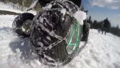 ATV riders on winter snow racing. Super slow motion of snow fly toward camera Stock Footage
