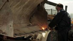 Stock Video Footage of Welder cutting with welding machine. Male worker welding shovel of bulldozer.