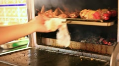 Chef checks meat skewers on readiness in Oven and close the oven. HD. 1920x1080 Stock Footage