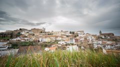 Time Lapse of Caceres, cloudy sky, grass in the foreground Stock Footage