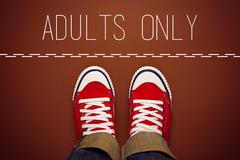 Adults Only Concept, Person Standing at Dividing Line - stock photo