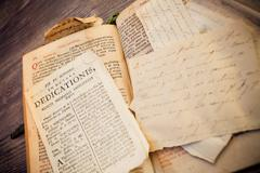 Stock Photo of Open religious 300 years old roman book with calligraphy in latin language